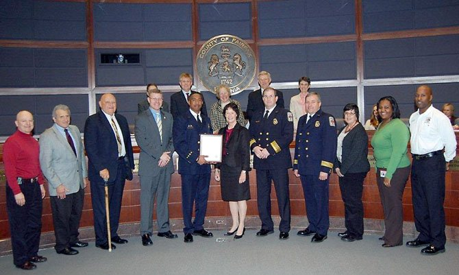 Capt. Willie Bailey, fifth from left, is honored March 6 by Sharon Bulova and the Fairfax County Board of Supervisors for his more than 1,000 hours of volunteer service to the community.