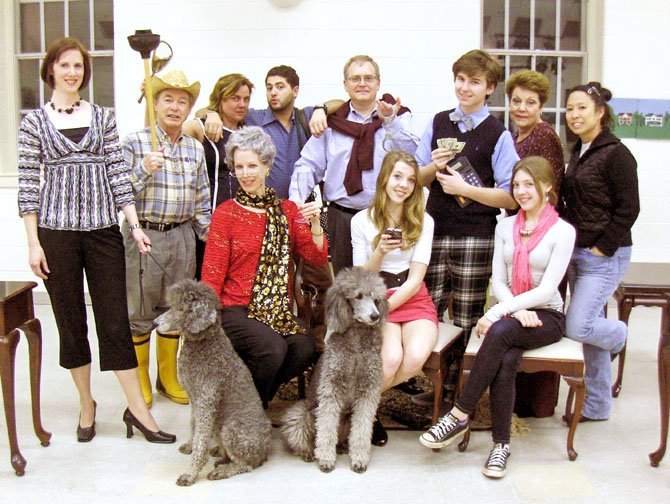 The cast of Maid for Dogs, (standing, from left) Stephanie Lawrence, Charles Hoffman, Elizabeth Vittori, Walid Chaya, Jim Manchester, Maxwell Snyder, Helen Rusnak and Charlotte Yakovleff, and (sitting, from left) Lynne Strang, Andie Matten and Roxy Matten. Dogs are Abby and Izzy.