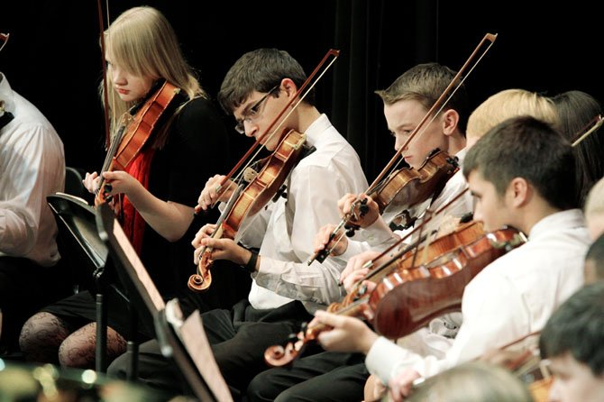 Students in the St. Stephen's & St. Agnes School orchestra perform at their winter concert in Alexandria. Experts say music activities can enhance social development.