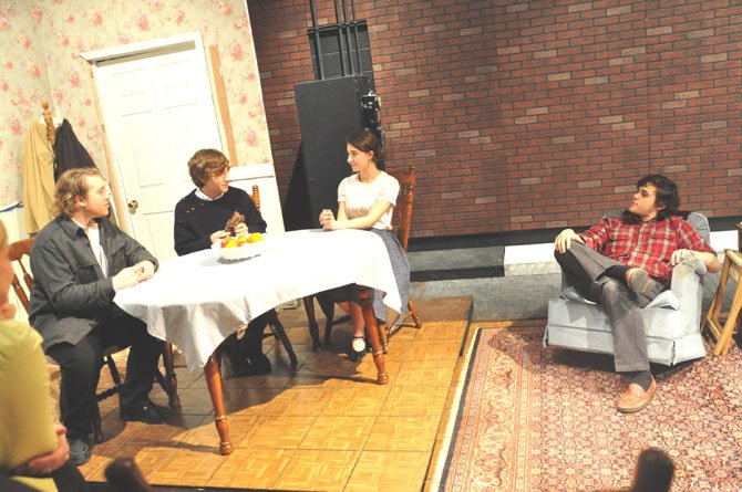 "From right, Damian Leverett as Eddie Carbone, Siena Richardson as his wife Beatrice as they welcome illegal immigrants from Italy. Rodolpho, played by Max Johnson and Marco, played by John Williams in the McLean Theatre Company's presentation of ""A View From the Bridge."""