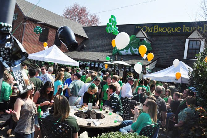 Patrons of The Old Brogue in Great Falls fill the front porch during their annual St. Patrick's Day celebration Saturday.