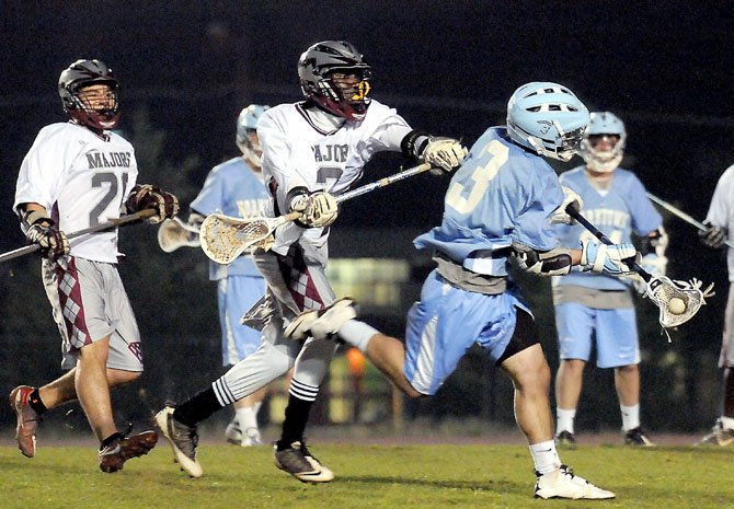 Yorktown senior midfielder Martim Cohen possesses the ball against Mount Vernon on March 16.