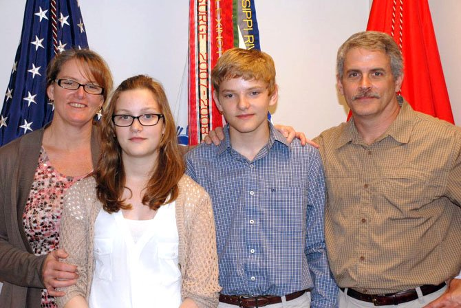 Travis Catina with his family: mother, Cate, who is a lieutenant colonel currently serving at Ft. Belvoir; sister, Rebecca, a sixth grader at Lorton Station; and father, Rich, who retired this year after 20 years of service in the Army as a member of the Special Forces.
