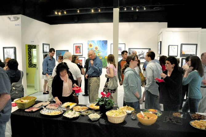 Herndon High School students, families and faculty gather at Herndon ArtSpace for the reception for the annual senior art show Friday, March 16. 