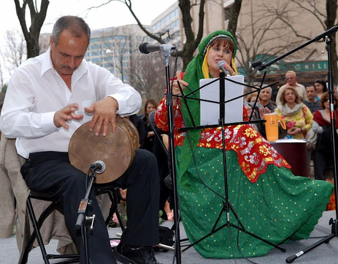 Iranian-American folk musicians performed traditional music for the large crowd.