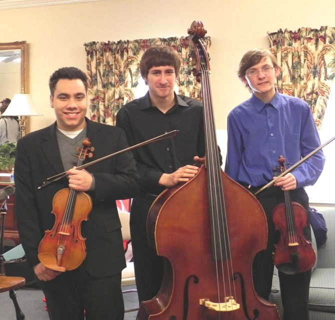 The three winners of the Fairfax Symphony Orchestra's Feuer Competition. From left - Third Prize: Cory Riviera, violin, home schooled, lives in Falls Church. Second Prize: Michael Lewis, bass, West Potomac. First Prize: Fedor Ouspensky, violin, South Lakes.