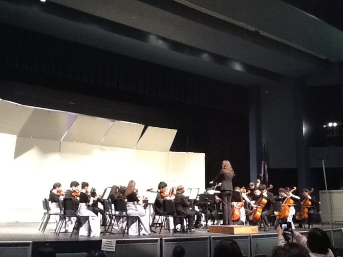Bo-Min Son conducts the Cooper Middle School Symphonic Orchestra.