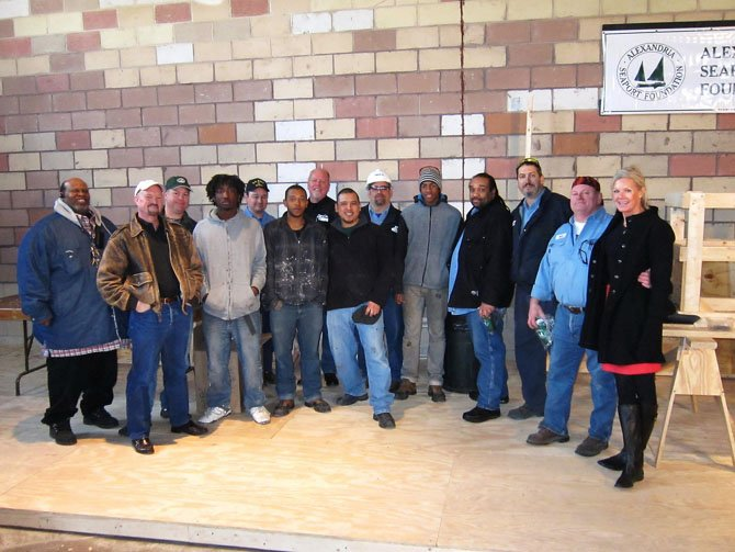 GenOn representatives joined Alexandria Seaport Foundation staff and apprentices February at the ASF workshop. From left: Darius Ligon (ASF), Kent Barnekov (ASF), Howell Crim (ASF), Chris (ASF apprentice), Chuck Kania (GenOn), Michael (ASF apprentice), Dale Hall (GenOn), Steve Hernandez (ASF), Dewayne Crone (GenOn), Maurice (ASF apprentice), Gene Davis (GenOn), Nick Folden (GenOn), Mark DeBoe (GenOn) and Kathy Seifert (ASF).