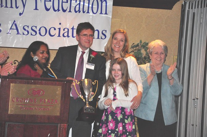 From left, Fairfax County Federation of Citizens Associations President Tania Hossain, Walter Alcorn of the Fairfax County Planning Commission, his wife Kristina, daughter Delia and former Board of Supervisors Chair Katherine Hanley. Alcorn was awarded the federation's Citizen of the Year award Sunday, March 25.