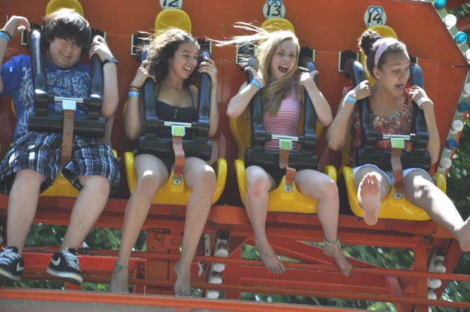 From left, Brian Hernandez, 14, Sarah Sinnas, 14, Hanna Andrews, 14 and Apiding Osika, 13, ride the Full Tilt at McLean Day. This year's festival will take place May 19.