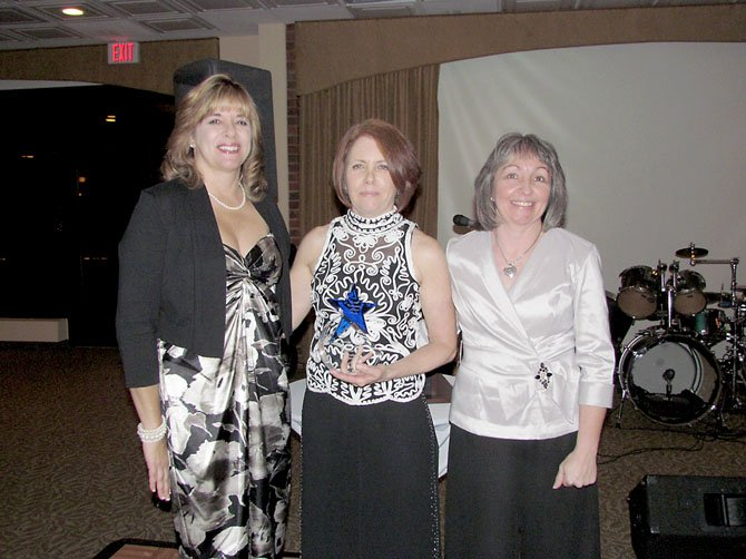 "Barbara Rizer, center, stands with Lynn Swogger, LCAC's Board President, left, and Linda Patterson, LCAC Executive Director, after receiving the Founder's Award at LCAC's March 10 ""Spring into Action"" Gala."