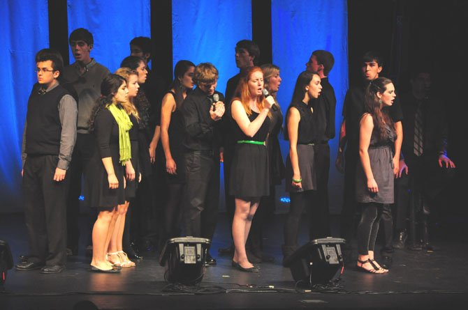 XIV Hours, an a cappella group from Durham, N.C. performs at the SingStrong event at South Lakes High School Saturday, March 24. The event, which featured a cappella performances and classes throughout the weekend, raised money for the Alzheimers Association. 