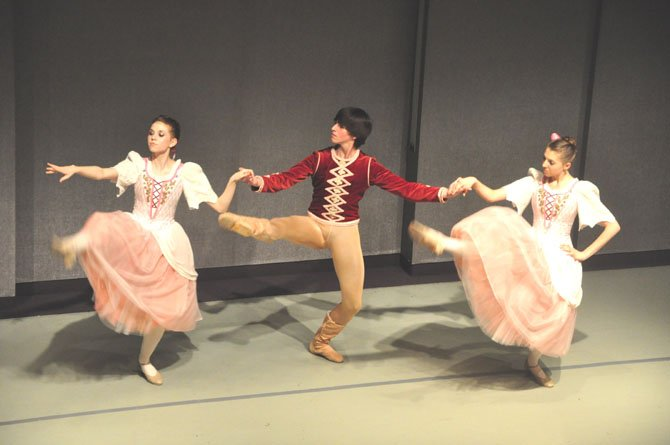"From left, Sydney Sasser, Peter Bacenet and Kaley Thornton perform the Hungarian Variation from ""Swan Lake"" during the Classical Ballet Theatre's annual Ballet and Bordeaux fundraiser Saturday, March 24."