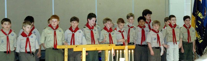 Posing for a photo are the newest members of Boy Scout Troop 913, 18 scouts graduating from Cub Scout Pack 913 at Dranesville Elementary School last Friday.