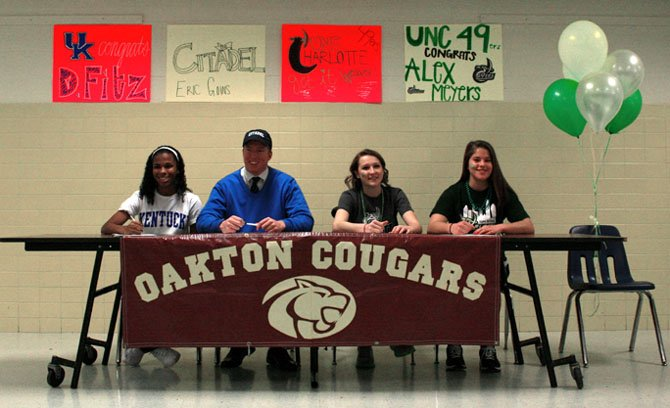 Four Oakton High School student-athletes celebrated their National Letters of Intent at a reception in their honor last month. From left to right: Danielle Fitzgerald, who will play soccer at Kentucky; Eric Goins, set to play football at The Citadel; and Alex Weaver and Alex Meyers, both of whom will play soccer at the University of North Carolina-Charlotte.