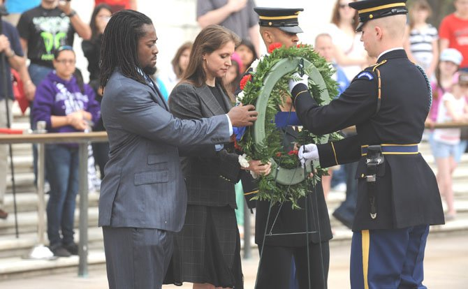 WWE Executive Vice President of Creative Stephanie McMahon and WWE Superstar Kofi Kingston participated in a wreath-laying ceremony on March 22 at the Tomb of the Unknown Soldier. After the ceremony, they were joined by WWE Superstar Mick Foley and WWE Divas The Bella Twins to pay a special visit to wounded military personnel at the Walter Reed National Military Medical Center.