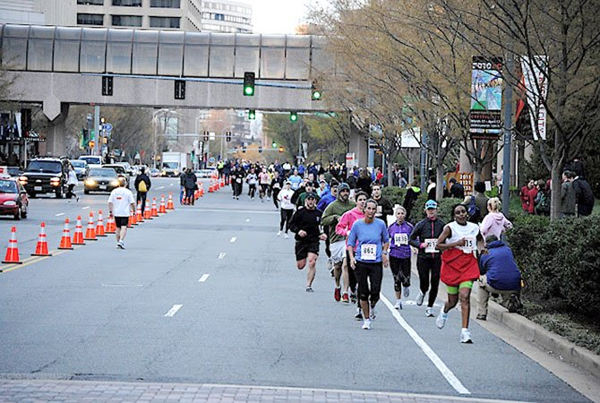 Racers from last year's Friday 5k take ro the streets of Crystal City. Event organizers expect 1,000 participants per event during this year's spring run series.