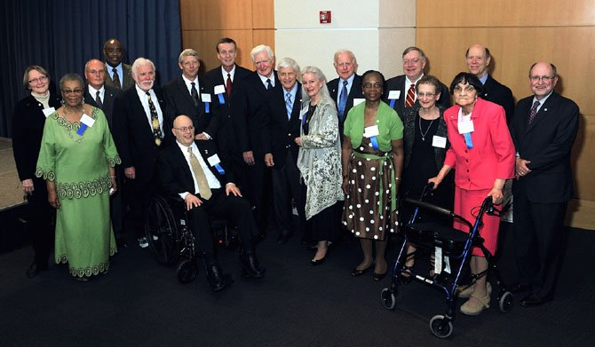 "The Legends of 2012: L-R First Row, Lillian Patterson, Mike Oliver, Al Grande, Allen Lomax, Bill Kehoe, Rep. Jim Moran, Harry ""Bud"" Hart, Wendy John, Gwen Menefee-Smith, Living Legends director  Nina Tisara, Dorothy Turner; L-R Second Row, Pat Miller, Jimmie McClellan, Mayor Bill Euille, Bob Calhoun, Joe Shumard, Eugene Steurele and Master of Ceremonies John Porter."