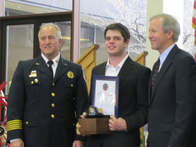 "Duncan Seguin, 16, receives the ""everyday hero"" award from Chief Richard Bowers and Councilmember Phil Andrews."