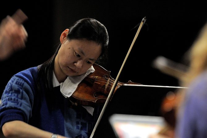 Violinist Midori performed with students from T.C. Williams High School in March.