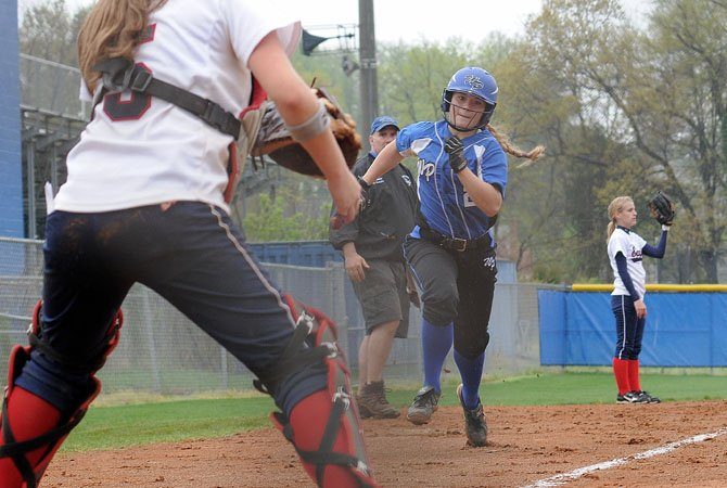 West Potomac senior Danielle McHugh rounds third and heads for home during the Wolverines' 15-1 win against Edison on March 24.