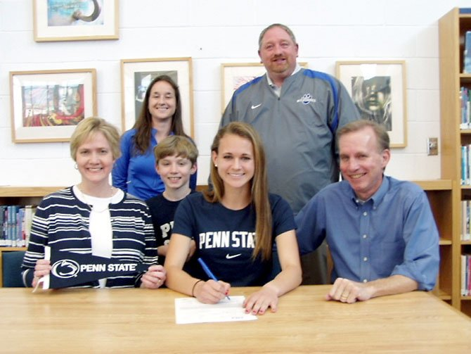 West Potomac senior Sarah Jane Underwood will run for Penn State University. Pictured from left to right are: (first row) Mary Underwood (mother), David Underwood (brother) Sarah Jane Underwood, Dave Underwood (father), (second row) Coach Jenn Dietz, DSA Aaron Helmick.