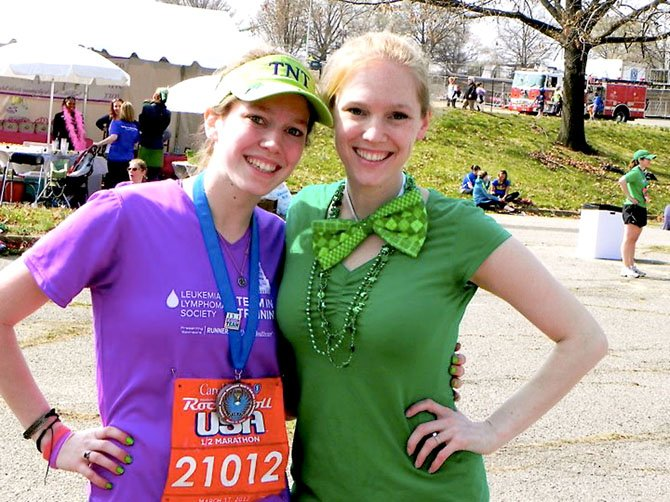 Mary McLaughlin (on left) at the half-marathon with her sister, Sarah, who came from Philadelphia to cheer her on.