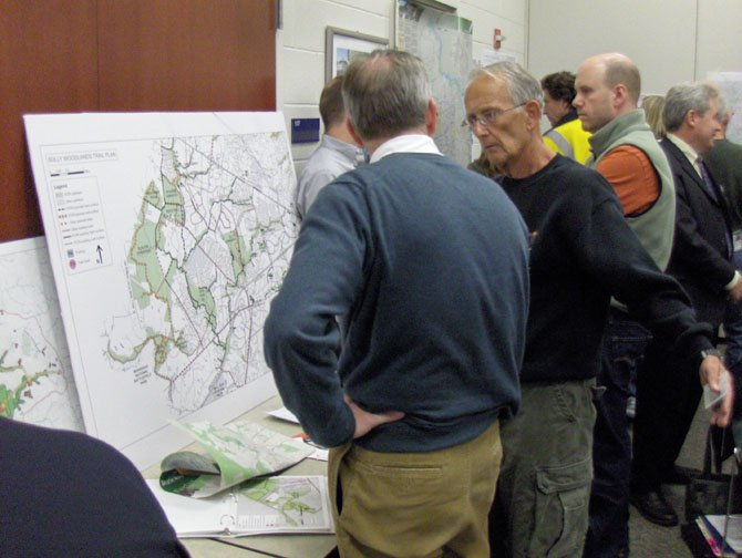 Local residents peruse maps of existing county bike trails.
