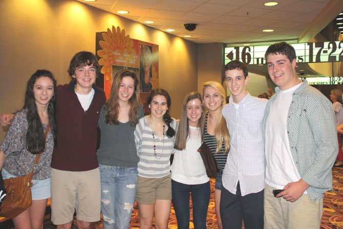 Quinn Hynes, second right, with friends at AMC opening weekend of the Hunger Games. Hynes' character is featured in the first minutes of the film.