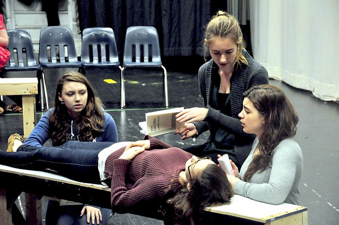 "The girls of Salem try to revive Betty Parris, played by Rachel Mayman, during Langley High School's upcoming production of ""The Crucible."""