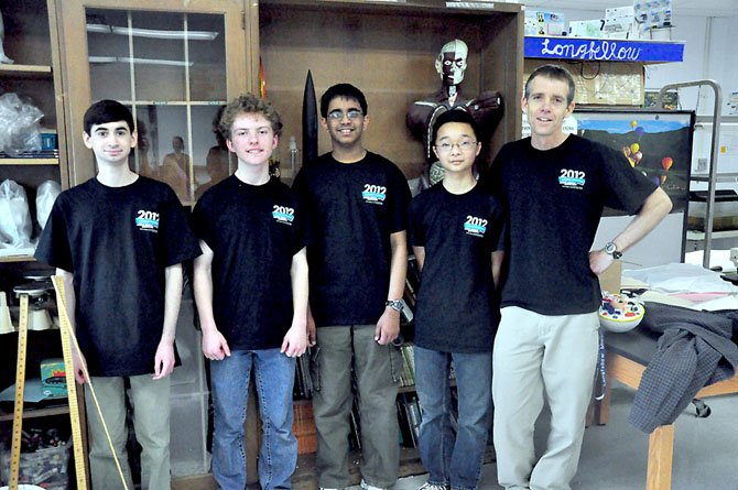From left, Longfellow eighth graders Ryan Golant, Ross Dempsey, Tarun Kamath and Keaton Lee, members of the school's science bowl team, with science teacher James Bradford. The team will be competing in the National Science Bowl in Washington, D.C. later this month.