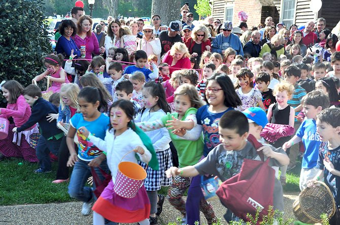 Children are unleashed to the Great Falls Village Green to hunt for Easter eggs Sunday, April 1 during the annual egg hunt.