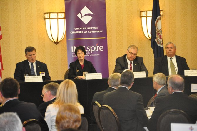 From left, Virginia Secretary of Transportation Sean Connaughton, Fairfax County Board of Supervisors Chair Sharon Bulova, Loudoun County Board of Supervisors Chair Scott York and Metropolitan Washington Airports Authority President Jack Potter speak at a Greater Reston Chamber of Commerce event Wednesday, March  28.