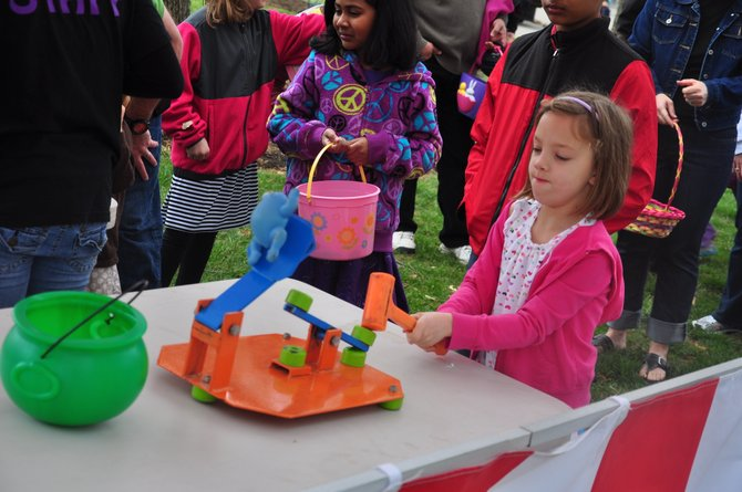Sarah Culver, 7, plays a game during the Eggnormous Egg Hunt at Brown's Chapel Park Saturday, March 31.
