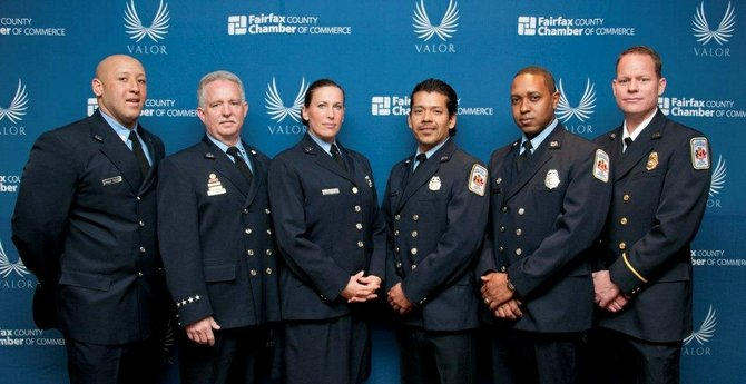 Firefighter Brandon Winfield, Technician Michael Frames, Firefighter Namaste Bosse, Technician Rolando Contreras, Master Technician Reginald Wadley and Lt. Erick Weinzapfel of Herndon Fire Station 39 were honored March 21 at the Fairfax County Valor Awards for their acts of heroism during the flash flooding of Sept. 8, 2011.
