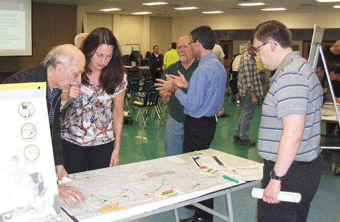 Residents discuss potential bike paths while looking at a map of the local area.