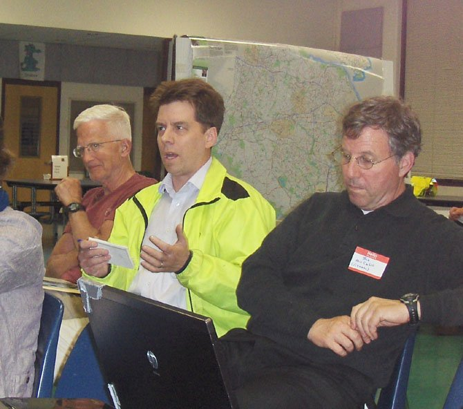 Fairfax resident Douglas Stewart (center) makes a point during the bike-plan meeting.