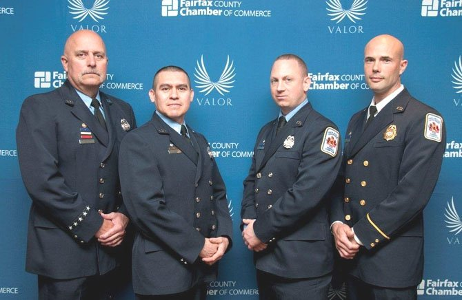 Technician Clay Slaymaker, Technician Edwin Flores, Firefighter Brendan Downing and Lt. Aron Corwin were honored March 21 for their heroism during a swift water rescue in Lorton last September.