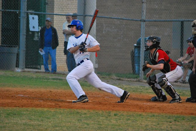 Senior outfielder Michael Francis makes contact at the plate for the Seahawks.