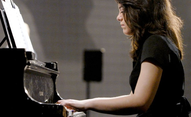 Maddie Rosenstein, a sophomore at Oakton High School, plays the piano for the Oakton High School Jazz Band B.