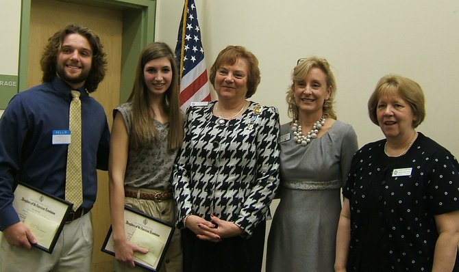 Vienna Students Win DAR Awards – from left: CJ Reimann of Oakton High School and Elizabeth Leavitt of James Madison receive their DAR Good Citizens Awards from Fairfax County Chapter Regent Elizabeth Bays and Good Citizens committee co-chairmen Amy Cartwright and Leigh Pomponio.