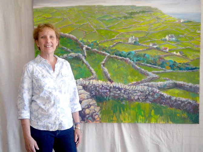 "Artist Elaine Hurst and her painting ""Walls of Stone."""
