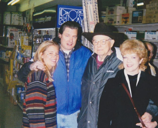 Lehman H. Young celebrated a portion of his 82nd birthday in 1998 at Fairfax Hardware. He is standing with his niece, Linda Young; nephew, Howard Young; and daughter Deborah Young.