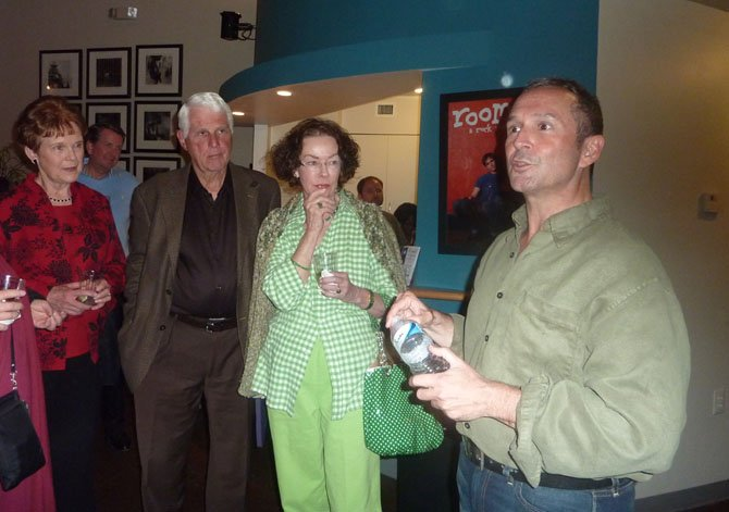 "Jay Alvarez talks with audience members following a performance of ""Be Careful! The Sharks Will Eat You"" at MetroStage."