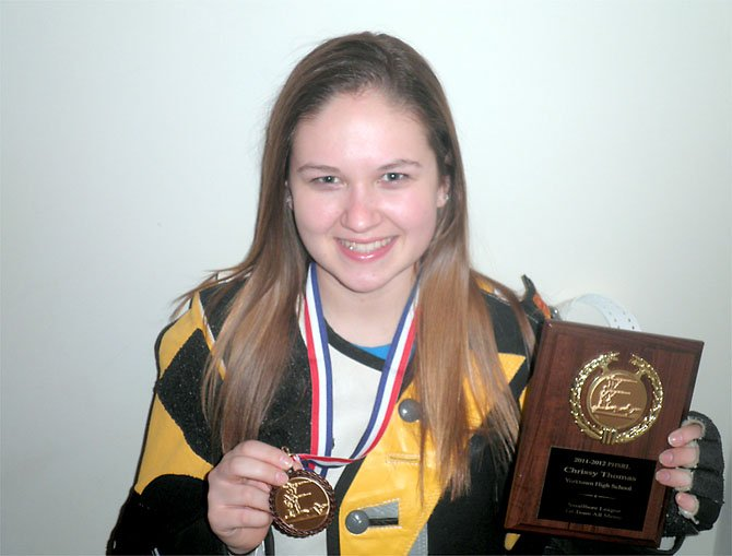 Chrissy Thomas with her medal for third place Potomac Rifle League and plaque naming her to the First Team All-Met.