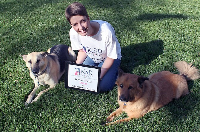 Karen Rosenberg, owner/principal of KSR Pet Care LLC with her dogs Lexie and Luka.