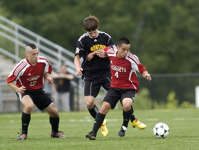 Herndon High senior midfielder Bryant Fernandez (4), shown here during the Hornets' Concorde finals versus Oakton last year, has six assists to his credit this spring.