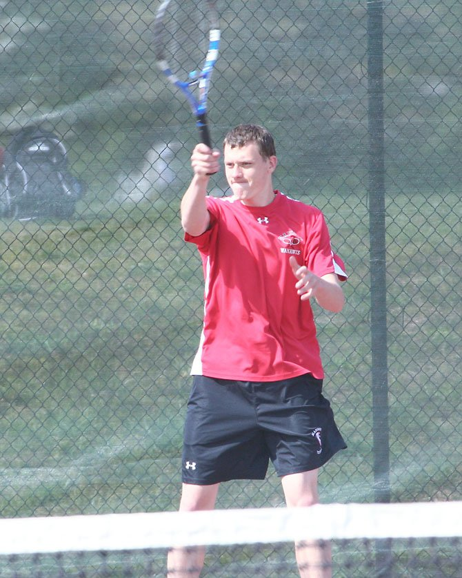 Madison High senior John Adam, shown here in his team's road match at South Lakes earlier this week, has played at No. 1 singles throughout the spring season for the Warhawks.