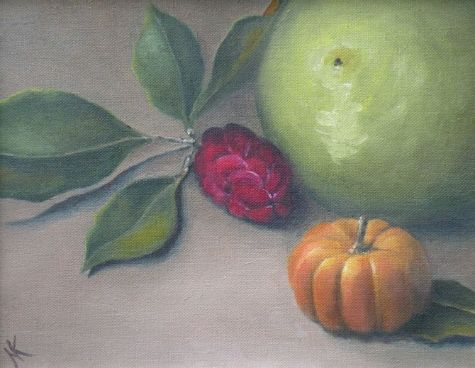 """Magnolia Pod,"" a painting by Nancy Keane, is a finely detailed still life. It is one of the featured pieces in the Great Falls Studios Spring Exhibit at the Great Falls Community Library."