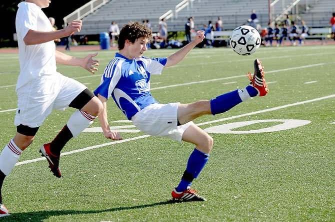West Potomac sophomore midfielder Ben Cermak kicks the ball against T.C. Williams on April 10 at Parker-Gray Stadium.